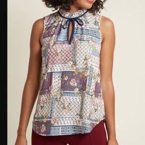 ModCloth sleeveless patchwork necktie blouse